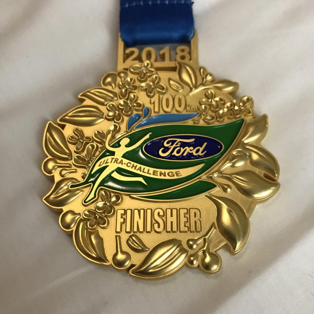 Krásná finišerská medaile, Číňani medaile prostě umí.